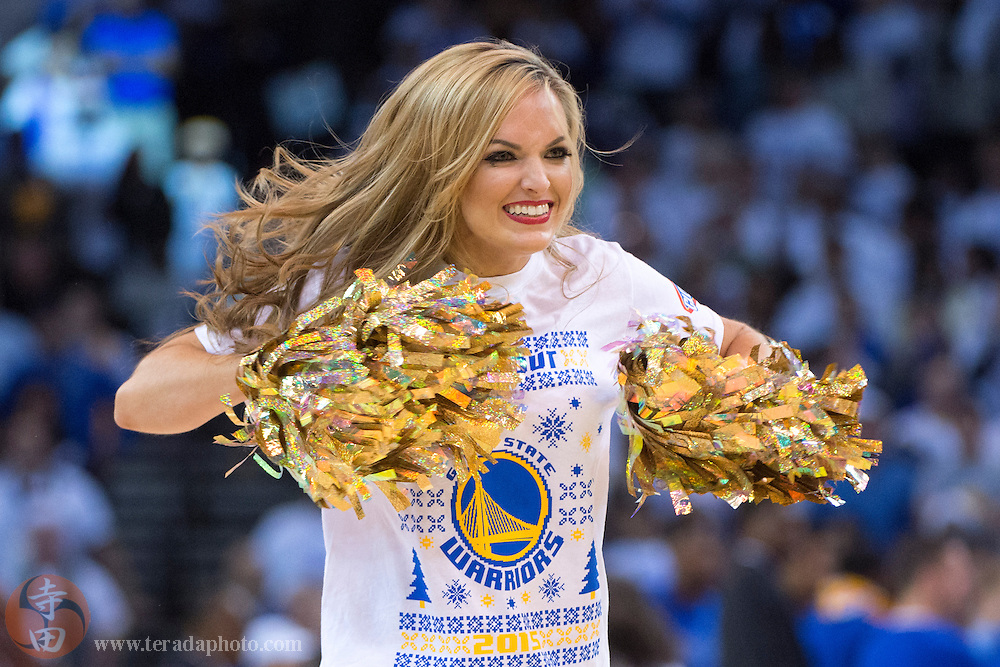 December 25, 2015; Oakland, CA, USA; Golden State Warriors Dance Team dancer Leigh performs during the fourth quarter in a NBA basketball game on Christmas against the Cleveland Cavaliers at Oracle Arena. The Warriors defeated the Cavaliers 89-83.