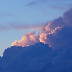 New Gloucester, MESunset colors light the clouds behind a thunderstorm.