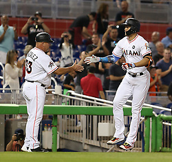 August 14, 2017 - Miami, FL, USA - Giancarlo Stanton runs the bases and gets a congratulatory handshake from third base coach Fredi Gonzalez as he breaks the Marlins' season homerun record hitting his 43rd dinger of the season as the Miami Marlins host the San Francisco Giants on Monday, Aug. 14, 2017 in Miami. (Credit Image: © Patrick Farrell/TNS via ZUMA Wire)