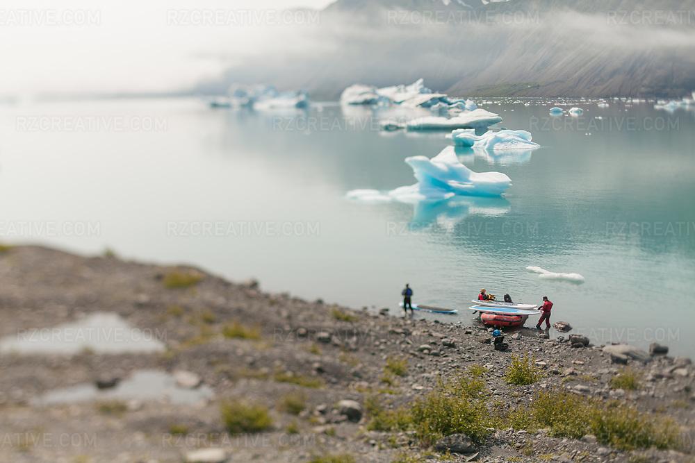 Standup paddling in Kenai Fjords National Park near Bear Glacier, Alaska. Photo © Robert Zaleski / rzcreative.com<br /> —<br /> To license this image contact: robert@rzcreative.com