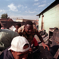 970105JS02:SAFRICA:UNREST:LIFE STYLES:POLITICS:APR94 - Self Defence Unit members take cover while bieng shot at in Tokoza during political violence prior to the first free elections in SA.(Photo by Joao Silva/PictureNET) charge gun attack ANC