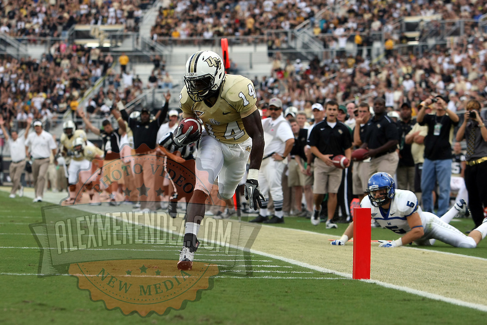 Central Florida wide receiver Quincy McDuffie (14) runs for a touchdown during an NCAA football game between the Memphis Tigers and the Central Florida Knights at Bright House Networks Stadium on Saturday, October 29, 2011 in Orlando, Florida. (AP Photo/Alex Menendez)