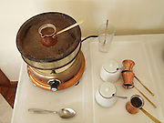 Greece, slow cooking Greek Coffee on an electric plate