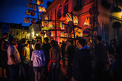 Late night Bastille day party in the streets of Honfleur , France