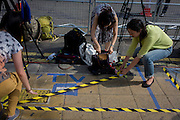 Foreign media mark out tape for their TV broadcasts outside St Mary's Hospital, Paddington London, where media and royalists await news of Kate, Duchess of Cambridge's impending labour and birth to a baby boy. Some have been camping out for up to two weeks during a UK heatwave, having bagged the best locations where the heir to the British throne will eventually be shown to the waiting world.