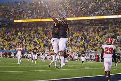 Sep 8, 2018; Morgantown, WV, USA; West Virginia Mountaineers wide receiver Gary Jennings Jr. (12) celebrates with West Virginia Mountaineers wide receiver David Sills V (13) after catching a touchdown pass during the second quarter against the Youngstown State Penguins at Mountaineer Field at Milan Puskar Stadium. Mandatory Credit: Ben Queen-USA TODAY Sports
