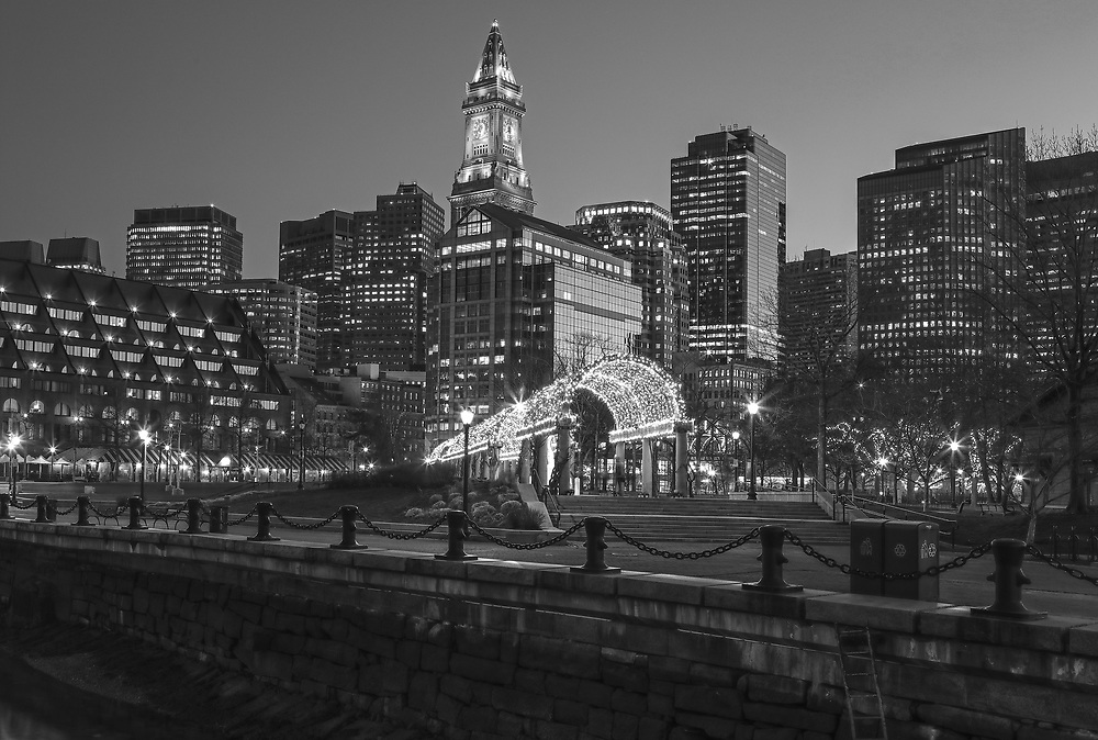 B & W Boston North End Christopher Columbus Waterfront Park night photography from New England Photography Guild member and award winning fine art photographer Juergen Roth showing Boston Custom House of Boston, the waterfront and parts of the Columbus Park and Boston Marriott Long Wharf hotel. The Boston skyline was photographed on a beautiful spring sunset. <br /> <br /> Black and White photos of Boston are available as museum quality photo prints, canvas prints, wood prints, acrylic prints or metal prints. Fine art prints may be framed and matted to the individual liking and fine art photography decor needs:<br /> <br /> https://juergen-roth.pixels.com/featured/black-and-white-boston-north-end-juergen-roth.html<br /> <br /> All digital Boston skyline photography images are available for photo image licensing at www.RothGalleries.com. Please contact me direct with any questions or request.<br /> <br /> Good light and happy photo making!<br /> <br /> My best,<br /> <br /> Juergen<br /> Prints: http://www.rothgalleries.com<br /> Photo Blog: http://whereintheworldisjuergen.blogspot.com<br /> Instagram: https://www.instagram.com/rothgalleries<br /> Twitter: https://twitter.com/naturefineart<br /> Facebook: https://www.facebook.com/naturefineart