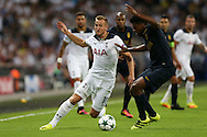 Harry Kane of Tottenham Hotspur goes past Jemerson of AS Monaco. UEFA Champions league match, group E, Tottenham Hotspur v AS Monaco at Wembley Stadium in London on Wednesday 14th September 2016.<br /> pic by John Patrick Fletcher, Andrew Orchard sports photography.
