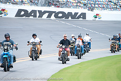 Motorcycle Cannonball riders ride the Daytona Speedway on Thursday before the Friday start of the Motorcycle Cannonball Cross-Country Endurance Run. Daytona Beach, FL, USA. September 4, 2014.  Photography ©2014 Michael Lichter.