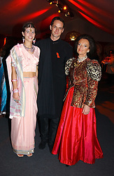 "Left to right, JAMES & CAROLINE JOHNSTONE he was chairman of the ball and LADY NEWALL at the 10th annual British Red Cross London Ball.  This years ball theme was Indian based - ""Yaksha - Yakshi: Doorkeepers to the Divine"" and was held at The Room, Upper Ground, London on 1st December 2004.  Proceeds from the ball will aid vital humanitarian work, including HIV/AIDS projects that the Red Cross supports in the UK and overseas.<br />