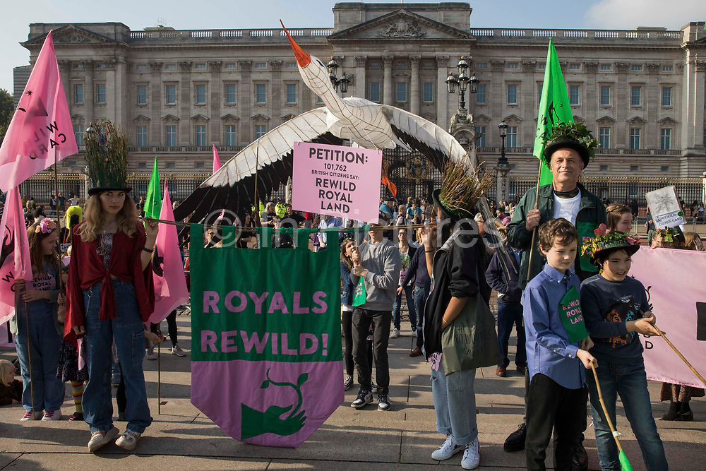 Conservationist and broadcaster Chris Packham joins children taking part in a Rewild Royal Land procession to Buckingham Palace organised by Wild Card, a new campaign calling on the UK's biggest landowners to rewild, and 38 Degrees on 9th October 2021 in London, United Kingdom. Campaigners are calling on the Royal Family, the largest landowning family in the UK, to rewild their estates in order to assist with tackling the climate crisis and a 14-year-old boy presented a petition at the gates of Buckingham Palace signed by over 100,000 people.