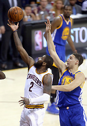 The Cleveland Cavaliers' Kyrie Irving (2) drives past the Golden State Warriors' Klay Thompson in the first half during Game 4 of the NBA Finals at Quicken Loans Arena in Cleveland on Friday, June 9, 2017. (Photo by Phil Masturzo/Akron Beacon Journal/TNS) *** Please Use Credit from Credit Field ***