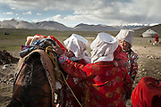 Moving with the Khan (chief) family. Tella Bu, daughter of the late Khan, is greeted, arriving from the Qyzyl Qorum winter camp to the summer camp of Kara Jylga, on the south side of the wide Little Pamir plateau...Trekking through the high altitude plateau of the Little Pamir mountains (average 4200 meters) , where the Afghan Kyrgyz community live all year, on the borders of China, Tajikistan and Pakistan.