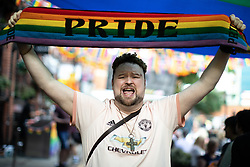 © Licensed to London News Pictures . 23/08/2019 . Manchester , UK . ANDREW DONOHUE (41 from Chorlton) wearing Manchester United and Manchester City kit to celebrate equality and diversity . People out in Manchester's Gay Village during the first day of Manchester Pride's Big Weekend . Photo credit : Joel Goodman/LNP