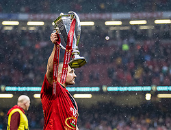 Ken Owens of Wales holds the Six Nations Trophy aloft <br /> <br /> Photographer Simon King/Replay Images<br /> <br /> Six Nations Round 5 - Wales v Ireland - Saturday 16th March 2019 - Principality Stadium - Cardiff<br /> <br /> World Copyright © Replay Images . All rights reserved. info@replayimages.co.uk - http://replayimages.co.uk