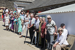 People wait to greet the Duchess of Cornwall and the Prince of Wales as they visit Dyfed Shire Horse Farm in Eglwyswrw in Pembrokeshire, Wales.