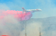 July 13, 2015 - Yorba Linda, CA, USA - <br /> <br /> water planes take to the sky to help put out fires<br /> <br /> An air tanker drops fire retardant on a vegetation fire that grew to burn more than 100 acres Monday morning, threatened some structures near Irvine Lake and caused officials to close down Santiago Canyon Road in unincorporated Orange County, California <br /> ©Exclusivepix Media