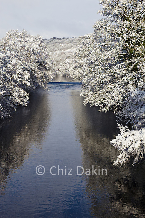 Snow-laden trees line the River Derwent after heavy overnight snow blankets much of Derbyshire