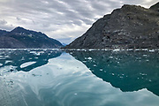 Calm water and icebergs.