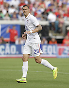 JACKSONVILLE, FL - JUNE 07:  Defender Geoff Cameron #20 of the United States runs upfield during the international friendly match against Nigeria at EverBank Field on June 7, 2014 in Jacksonville, Florida.  (Photo by Mike Zarrilli/Getty Images)