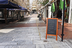 © Licensed to London News Pictures. 15/03/2020 . Athens , Greece .A sign is seen outside a coffee shop on Ermou high street in Central Athens . Greece shuts down shopping malls, bars, cafes, restaurants, beauty salons, libraries and archaeological sites to tackle the coronavirus  after a jump in cases, from 117 to 228. Restaurants providing only take-away and deliveries can stay open. Photo credit: Ioannis Alexopoulos /LNP