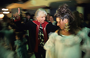 Manitas de Plata, the famous Gypsy guitarist, dances at the wedding of one of his grand nieces. Figuerolles, France 1994