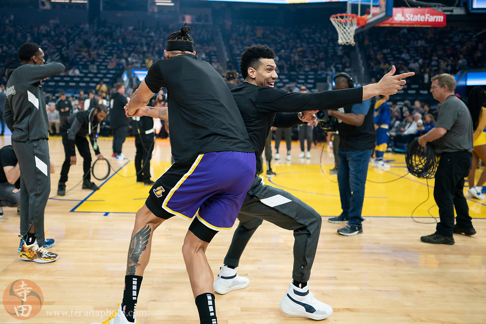 February 27, 2020; San Francisco, California, USA; Los Angeles Lakers guard Danny Green (14, right) and center JaVale McGee (7, left) doing a pre-game routine before the game against the Golden State Warriors at Chase Center.