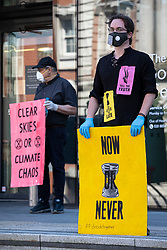 © Licensed to London News Pictures. 30/05/2020. London, UK. Extinction Rebellion protesters stage a silent, socially distanced demonstration outside the Woolwich Centre in southeast London. They are calling on councils and political leaders to better respond to Covid-19 and the climate crisis. Photo credit: Rob Pinney/LNP