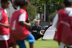 Prince Harry during a visit to a summer holiday activity session run by Newham CouncilÕs leisure trust at Central Park, East Ham, London.
