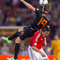 Netherlands' KIaas Jan Huntelaar (top) and Hungary's Zoltan Liptak (R) fight for the ball during a World Cup 2014 qualifying soccer match Hungary playing against Netherlands in Budapest, Hungary on September 11, 2012. ATTILA VOLGYI