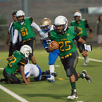 Skyhawks junior Deontay Begay, #25, finds a seam down the hash marks in the second quarter against the Zuni Thunderbirds Friday night in Newcomb.