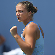 Sara Errani, Italy, in action against Ekaterina Makarove, Russia, during the New Haven Tennis Open at Yale,, Connecticut, USA. 20th August 2013. Photo Tim Clayton