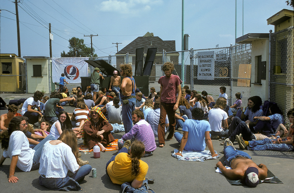 Deadheads hanging out early in the afternoon before the Grateful Dead Play Live at Dillon Stadium, Hartford, CT 31 July 1974. Featuring the Wall of Sound. A hot summer weekday show and people got there very early for one of the longest ever played by The Dead.