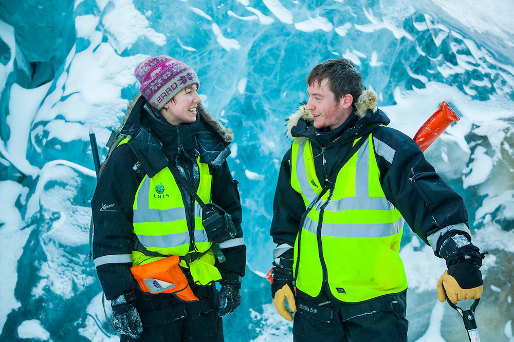 UNIS students Heïdi Sevestre (left) and Stephen Jennings chat on the broken surface of Rabotbreen, Svalbard on a class field trip.