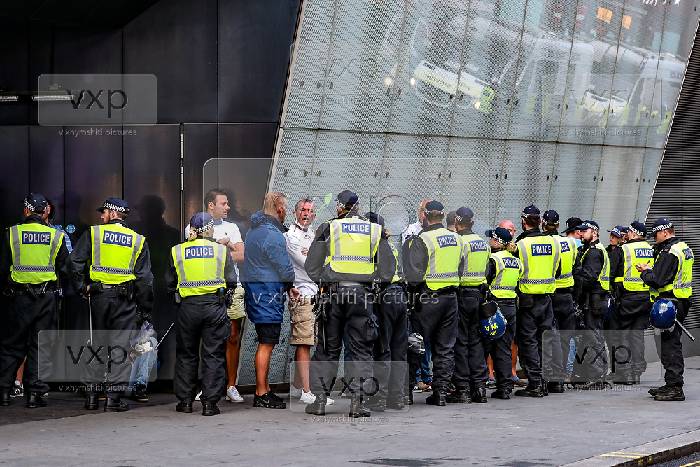 British mounted police officers try to contain members of the Far-Right Group during a protest at Leicester Square, in central London, Saturday, June 13, 2020. British police have imposed strict restrictions on groups protesting in London Saturday in a bid to avoid violent clashes between protesters from the Black Lives Matter movement, as well as far-right groups that gathered to counter-protest.<br /> Anger against systemic levels of institutional racism has raged through the city, and worldwide; sparked by the death of George Floyd, who was killed in Minneapolis, US, by a policeman who restrained him with force on 25 May 2020. (Photo/ Vudi Xhymshiti)