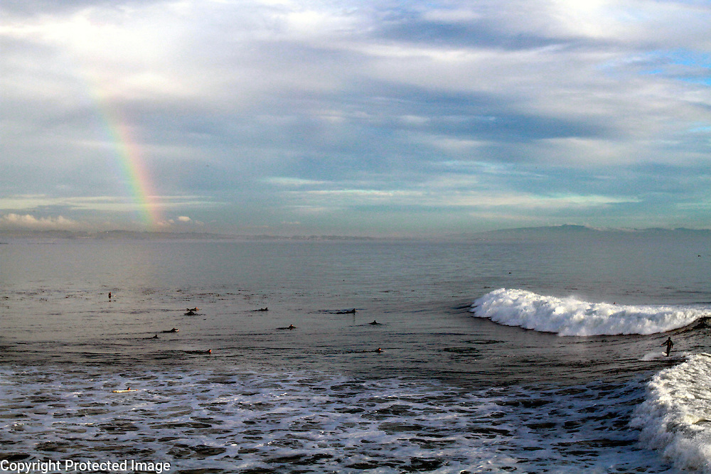The surfers pot of gold seems to be at Steamer Lane in Santa Cruz, California as a rainbow colors the sky during a large winter swell.<br /> Photo by Shmuel Thaler <br /> shmuel_thaler@yahoo.com www.shmuelthaler.com