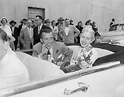Y-540612-057. Television show host Ed Sullivan and Rose Festival Queen Jan Markstaller in the Rose Festival Grand Floral Parade, June 12, 1954.