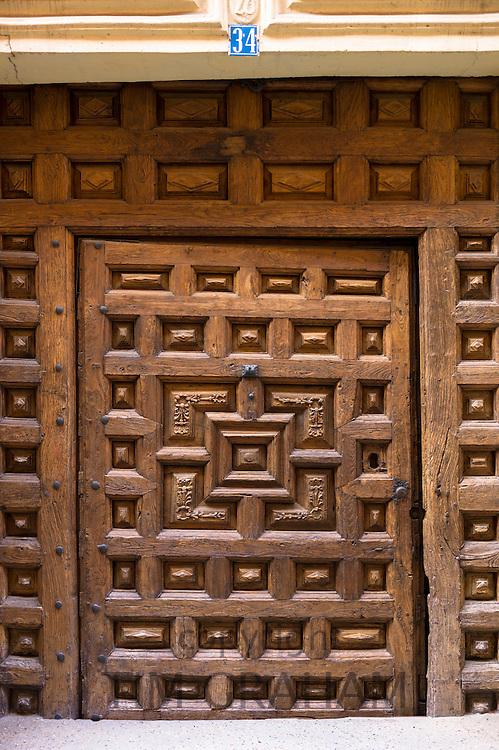 Wooden doorway in Santo Domingo de La Calzada on the Way of St James pilgrim route Camino de Santiago in Castilla y Leon, Spain