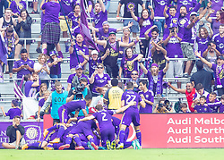 April 8, 2018 - Orlando, FL, U.S. - ORLANDO, FL - APRIL 08: Orlando City team celibrates the games winning goal during the MLS soccer match between the Orlando City FC and the Portland Timbers at Orlando City SC on April 8, 2018 at Orlando City Stadium in Orlando, FL. (Photo by Andrew Bershaw/Icon Sportswire) (Credit Image: © Andrew Bershaw/Icon SMI via ZUMA Press)