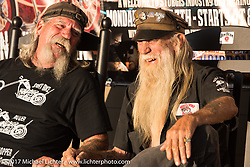 Mailman Kevin O'Brian (L) and Brother and Speed on the porch of the Iron Horse Saloon during the annual Sturgis Black Hills Motorcycle Rally.  SD, USA. Monday August 7, 2017. Photography ©2017 Michael Lichter.