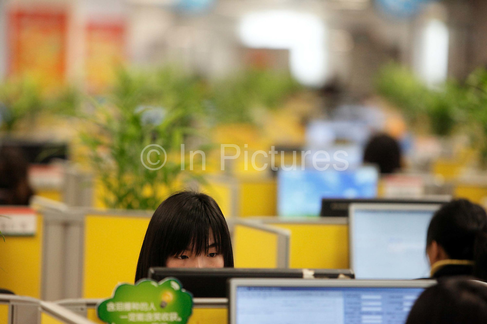 Employees work as the call center at the Ping An Insurance Group's operations base in Shanghai, China on 12 January 2010.  Ping An is one of the largest insurers in the world, topped only by China's government owned national insurer.