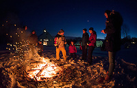 Visitors keep warm gathered around the bonfire during Prescott Farm Lantern Festival held Saturday evening.  (Karen Bobotas/for the Laconia Daily Sun)