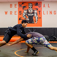 Miles Noble, left, and Rico Browning practices their takedowns during the Bengals wrestling workout at Gallup High School Thursday.