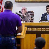 City councilors Allan Landvazo, left, and Yogash Kumar sit with mayor Jackie McKinney, center, during the city council meeting at Gallup City Hall Tuesday.