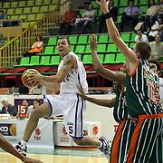 Anadolu Efes's Jordan Farmar (L) and Banvit's Vladimir Stimac (R) during their Turkish Basketball League match Anadolu Efes between Banvit at Ayhan Sahenk Arena in Istanbul, Turkey, Monday, October 15, 2012. Photo by TURKPIX