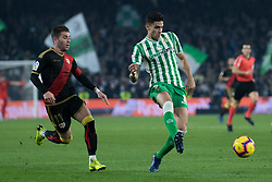 December 9, 2018 - Seville, Andalucía, Spain - Marc Bartra, Real Betis, and Embarba, Rayo, fight for the ball during the LaLiga match between Real Betis and Rayo in Benito Villamarín Stadium  (Credit Image: © Javier MontañO/Pacific Press via ZUMA Wire)
