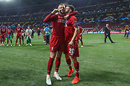 CHAMPIONS Liverpool players and staff celebrate and Liverpool midfielder Adam Lallana (20) kisses Liverpool midfielder Jordan Henderson (14) after Liverpool win the UEFA Champions League Final match between Tottenham Hotspur and Liverpool at Wanda Metropolitano Stadium, Madrid, Spain on 1 June 2019.