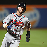 NEW YORK, NEW YORK - SEPTEMBER 26:  Dansby Swanson #7 of the Atlanta Braves rounds third base to score a run during the Atlanta Braves Vs New York Mets MLB regular season game at Citi Field, Flushing, Queens, on September 26, 2017 in New York City. (Photo by Tim Clayton/Corbis via Getty Images)