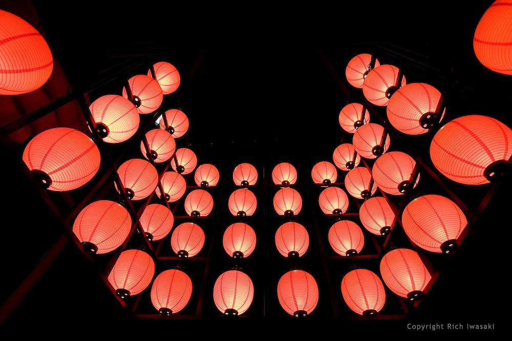 Lighted lanterns at night at entrance of Sumibiya restaurant, Miebashi district, Naha, Okinawa