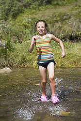 July 21, 2019 - Girl Running In Water (Credit Image: © Carson Ganci/Design Pics via ZUMA Wire)